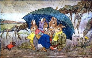 Raining, Pouring, the Bunnies are . . . huddled under an umbrella